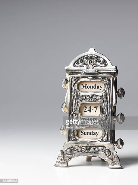 Antique 24/7 desk calendar