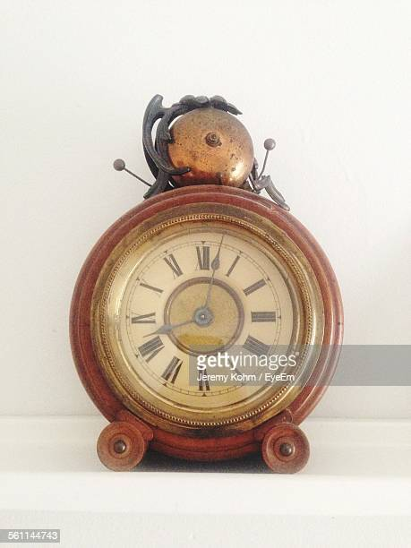 Antique Alarm Clock On Table