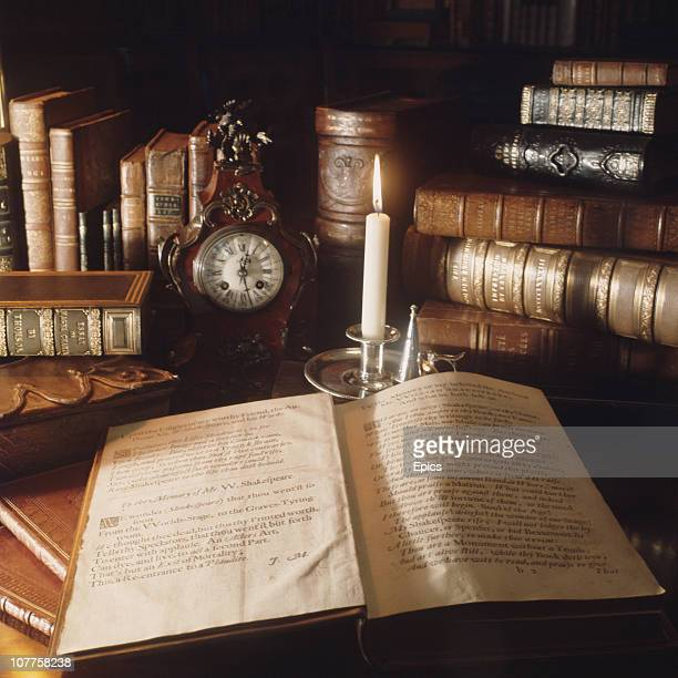 Antique and rare books including English playwright William Shakespeare's first folio are lit by candlelight in the library at Longleat stately home...