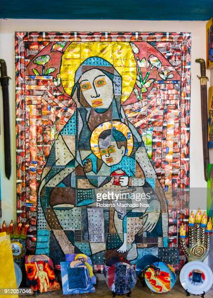 Antique art of the Virgin Mary and Jesus There are Cuban machetes on the side The image is taken on the house of the famous Cuban artist Ileana...