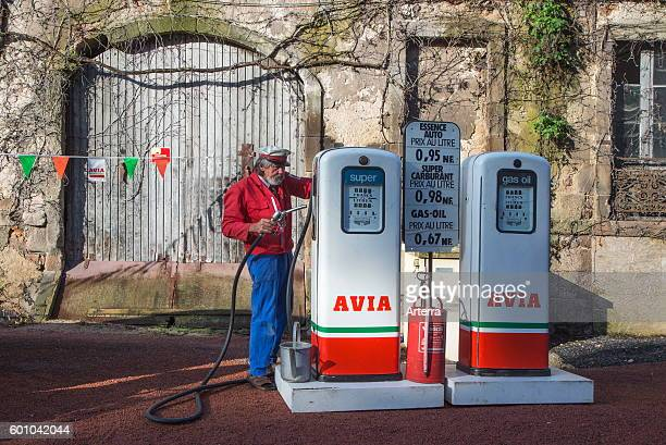 Antique Avia fuel pumps and service station attendant during the Embouteillage de la Route Nationale 7 happening for oldtimers from the fifties and...