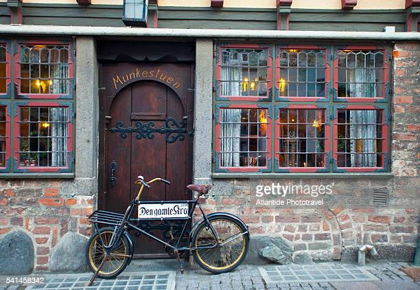 Antique bicycle at entrance of Den Gamle Kro restaurant