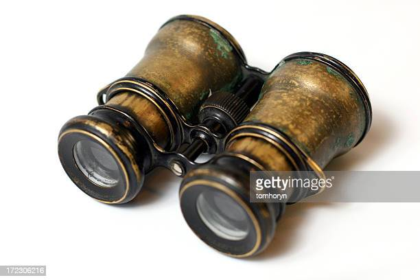 Antique binoculars isolated with white background