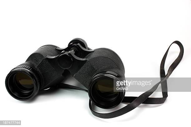 antique black binoculars laying on white background - strap stock photos and pictures