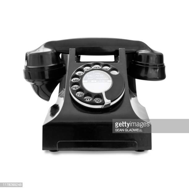 antique black telephone on white - retro style stock pictures, royalty-free photos & images