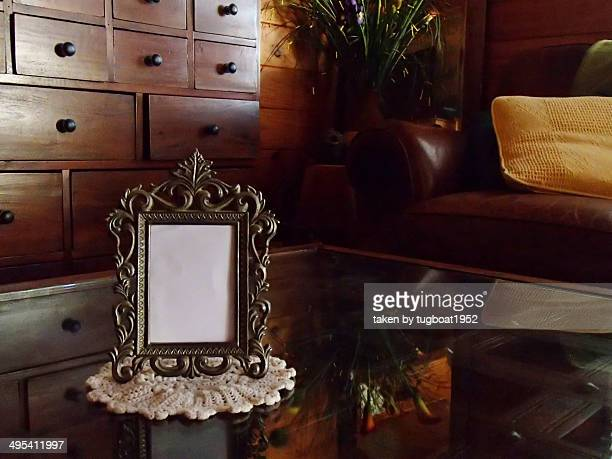 Antique blank frame on glass table