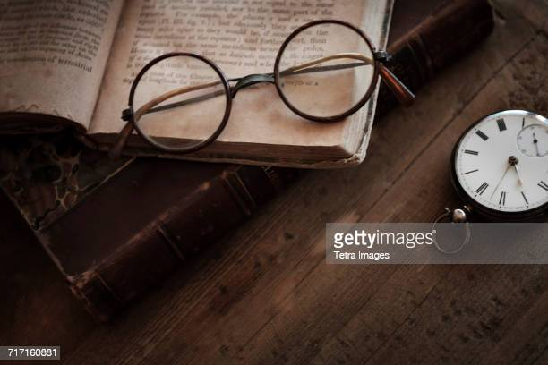 Antique book, watch and eyeglasses