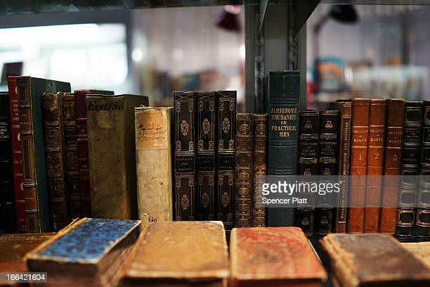 Antique books are displayed at the Park Avenue Armory which is hosting the New York Antiquarian Book Fair on April 12, 2013 in New York City. This...