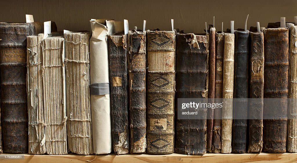 Antique books in a library : Stock Photo