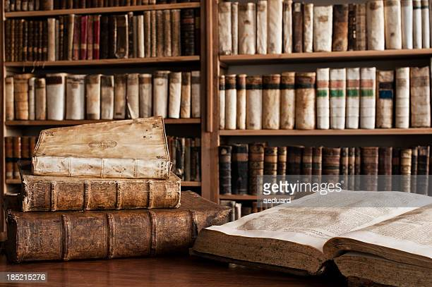 antique books in a library - antique stock pictures, royalty-free photos & images