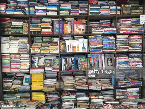 antique books on the shelves of a book store in alsancak, izmir, turkey - mixed magazine stock photos and pictures