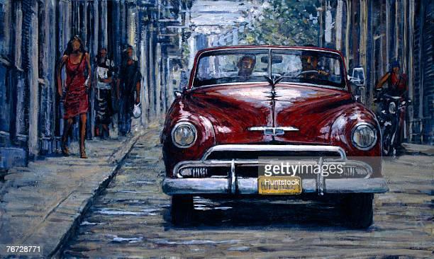 Antique car driving down street