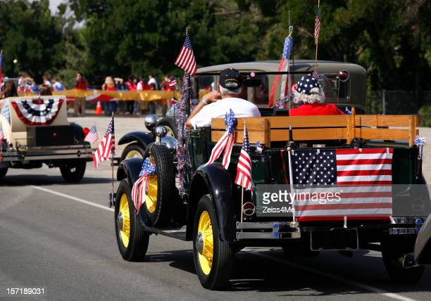 antique car in july 4th parade - parade stock pictures, royalty-free photos & images