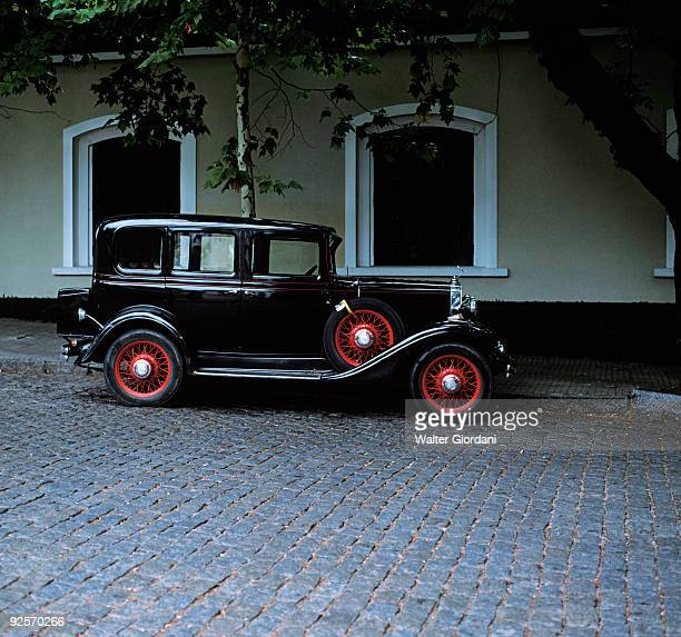 Antique car parked on street