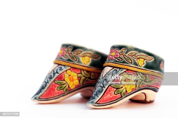 antique ceramic chinese lotus slippers - foot binding stock pictures, royalty-free photos & images