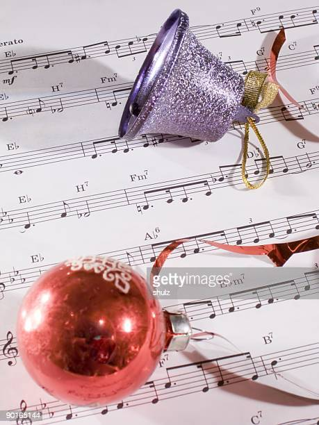 Antique christmas ornaments on the sheet music