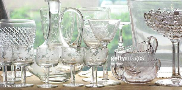 antique clear, cut crystal glassware on a window sill in a home or a store - etching stock pictures, royalty-free photos & images