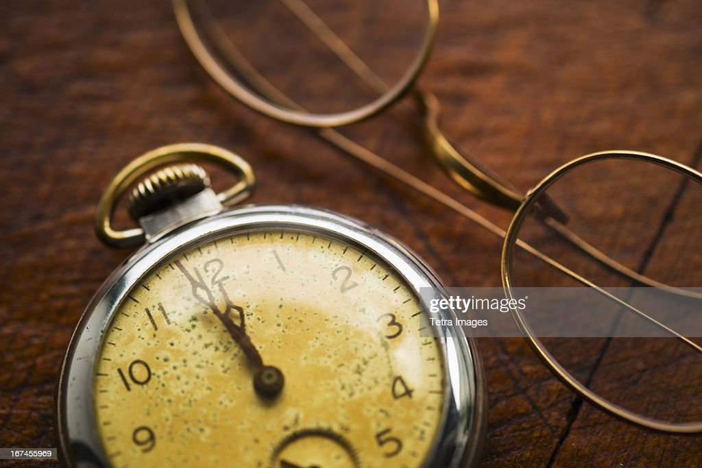 Antique clock and glasses : Stock Photo