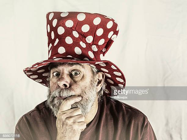 Antique Clown Hat Quizzical Senior Man