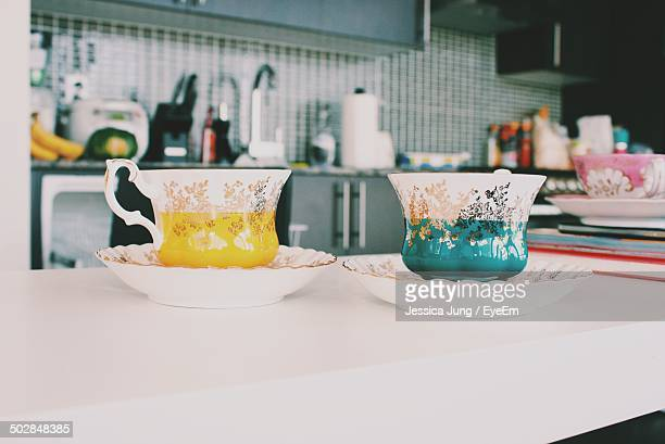 Antique designed tea cups on table at home