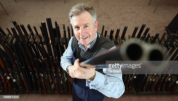Antique firearms expert Gavin Gardiner poses with a 12bore 'Russian Purdey' which is due to be auctioned on April 17 2013 in the 'Fine Modern and...