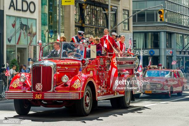 CONTENT] Antique firefighter engine and station car with a lot of happy passengers at Polaski parade in Manhattan