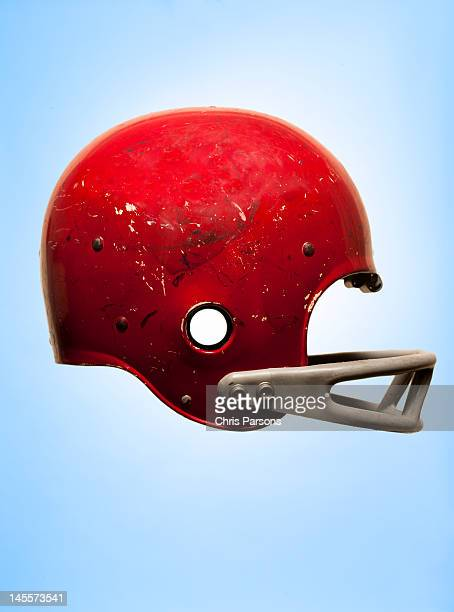 Antique football helmet on blue background