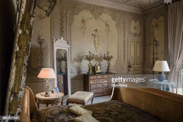Antique furnishings decorate a bedroom inside the Villa Les Cedres a 187yearold000squarefoot 14bedroom mansion set on 35 acres in SaintJeanCapFerrat...
