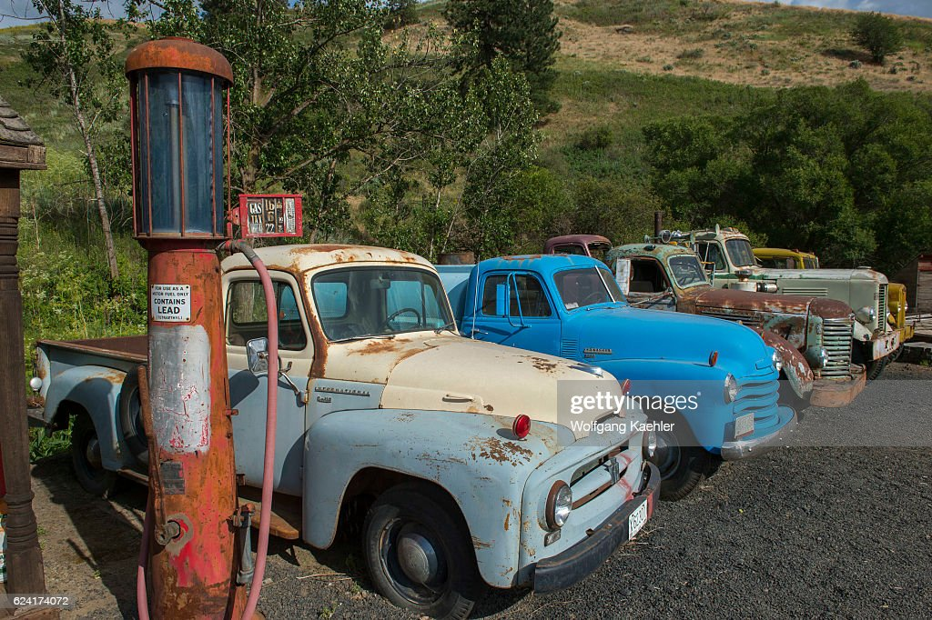 Antique Gas Pump And Cars At An Old Gas Station Part Of An
