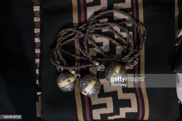 Antique gaucho bolas are displayed for sale at the exhibition pavilion during La Exposicion Rural agricultural and livestock show in the Palermo...