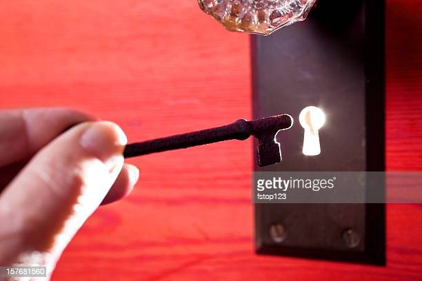 antique glass door knob and skeleton key light in keyhole - hotel key stock photos and pictures