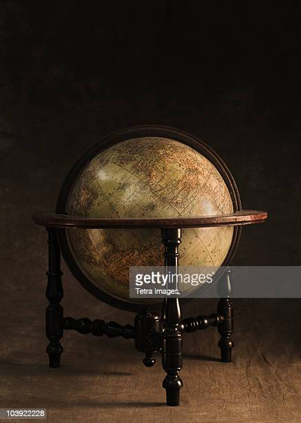Antique globe and stand