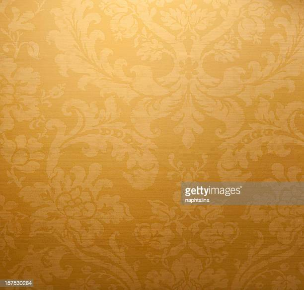 antique gold paper wall - velvet stock photos and pictures