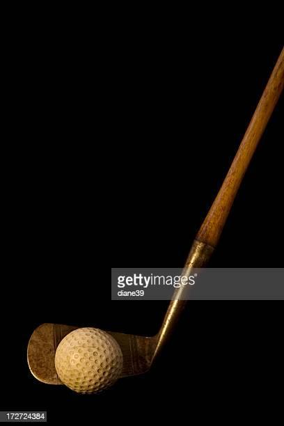 Antique golf ball and club