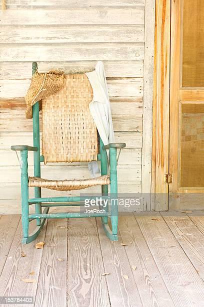 Antique Green Rocking Chair On Rustic Farm Porch