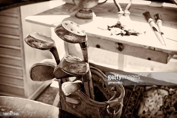 Antique handmade golf clubs, monochromatic, sepia tone