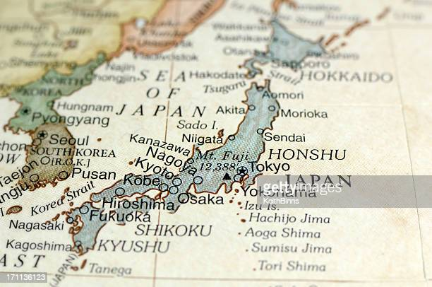 antique map displaying japan and surrounding areas - japan stock pictures, royalty-free photos & images