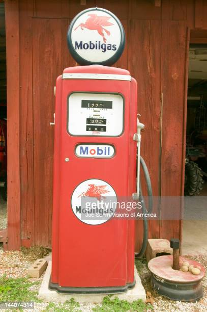 Antique Mobil gas pump in front of red barn off Manchester road Missouri
