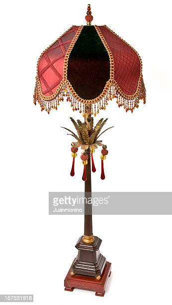 Antique old West lamp with black, gold and red cover