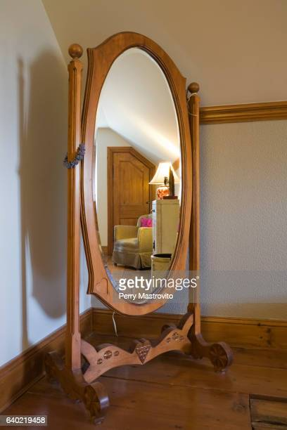 antique oval wooden revolving dress mirror - full length mirror stock photos and pictures