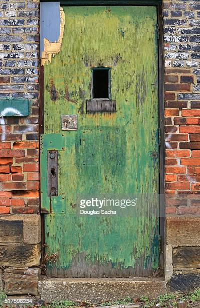antique painted front door - ugly wallpaper stock photos and pictures