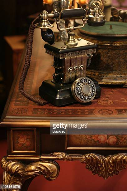Antique Phone on Victorian Style Table