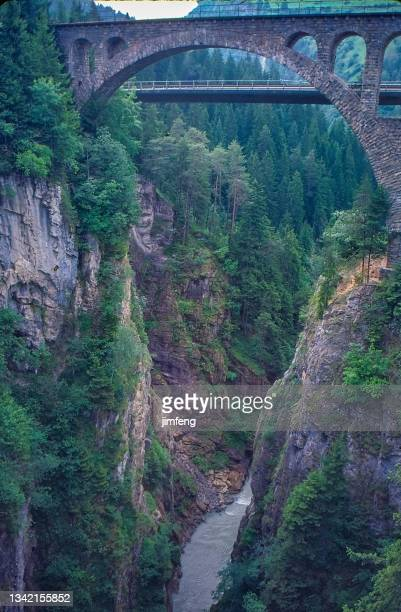 antique photo and old retro vintage style positive film scanned, 1980s view of the viaduct across a deep ravine in the swiss, chur, switzerland - 1980 1989 stock pictures, royalty-free photos & images