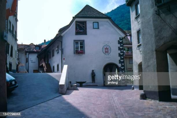 antique photo and old retro vintage style positive film scanned, 1980s street view, chur, switzerland - 1980 1989 bildbanksfoton och bilder