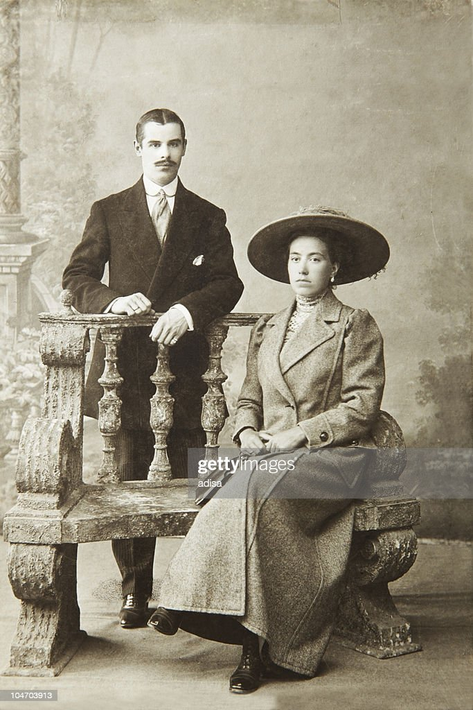Antique photo of a woman seated and a man standing : Stock Photo