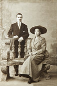 Antique photo of a woman seated and a man standing