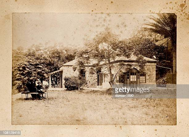 antique photograph of old house with young girl outside - sepia stock pictures, royalty-free photos & images