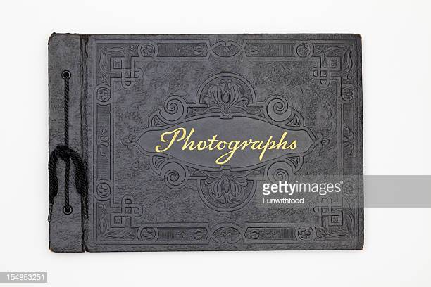 antique photography book cover, old black leather photograph album - photo album stock photos and pictures