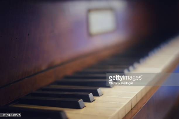 antique piano keyboard, black and white keys seen up close, made of wood - acoustic music stock pictures, royalty-free photos & images