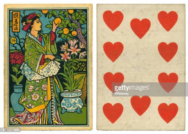 antique playing card back design japanese girl picking oranges 19th century - hearts playing card stock photos and pictures